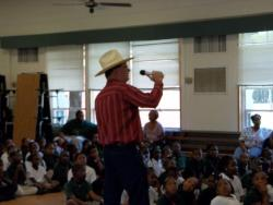 Williams sings a Ronnie Milsap song to Edgewood students, teacher