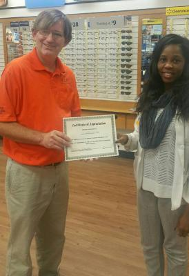 Wal-Mart vision center manager honored