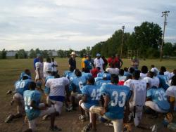 Selma HIgh School Football Coach Leroy Miles and his team