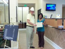 Bank teller given V.I.P. Customer Award