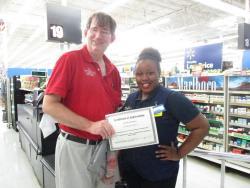 Selma WAL-MART employee receives customer service award